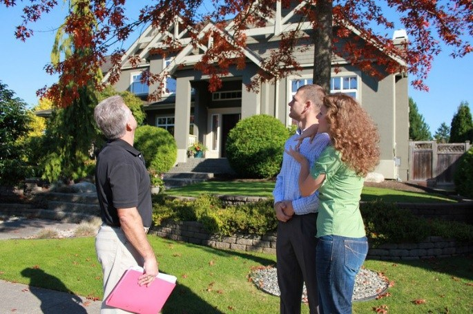 Realtor and the couple outside the house | Quest Property Inspections