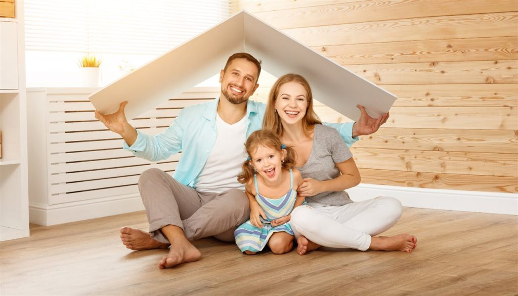 family under cardboard roof | Quest Property Inspections | New roofing Corona CA