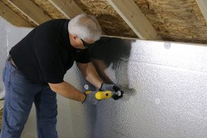 contractor works on the attic | Quest Property Inspections | energy bills Corona