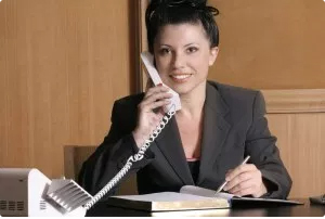 Lady on phone for Quest Property Inspections online schedule
